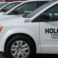 HOLCOMB BUS SERVICE logo