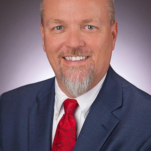 John E. Delzell