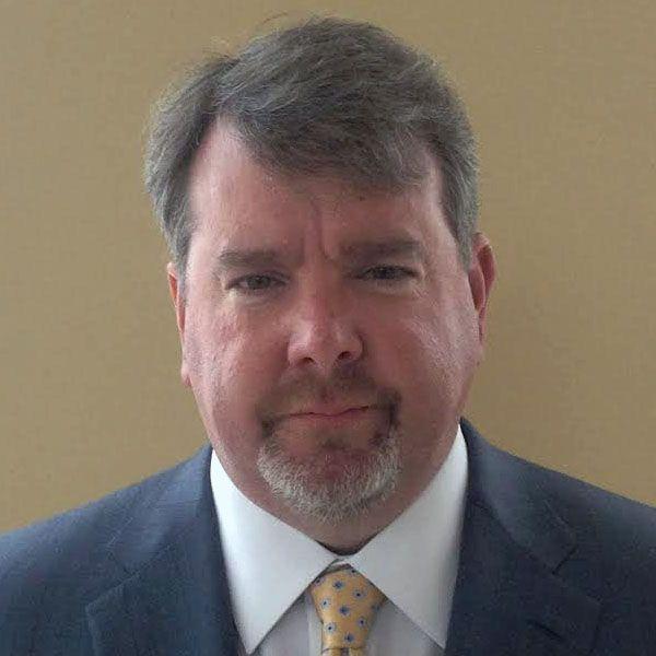 Mark E. Ricks