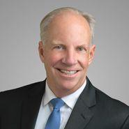 Mark E. Lutes